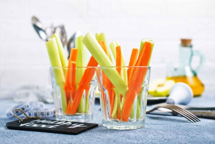 diet food, fresh celery and carrot in the glass