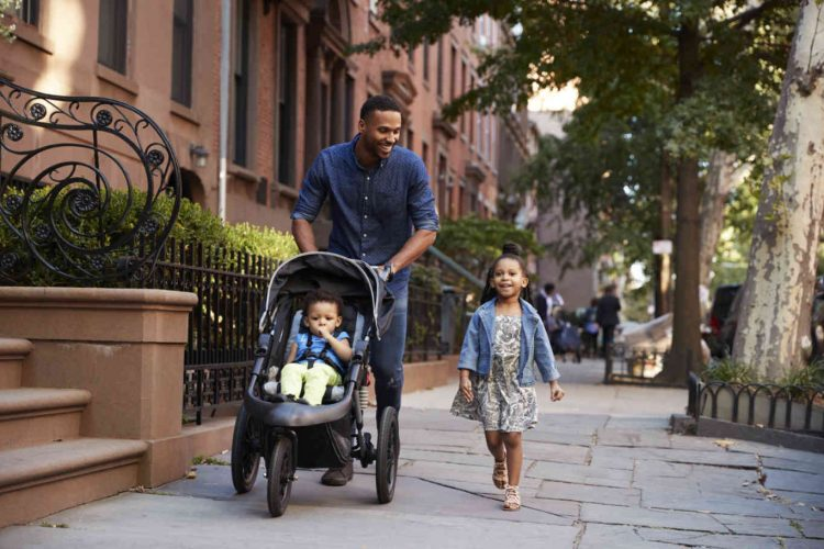 father-and-two-daughters-taking-a-walk